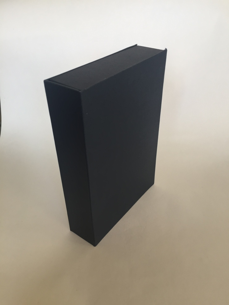 Image of a clamshell or drop spine box made from millboard and covered in blue bookcloth pictured closed and upright